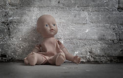 Abandoned doll Stock Image
