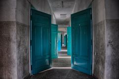 Abandoned doors,colorful door in deserted building, dying hospital stock images