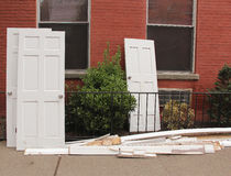 Abandoned Doors. A pile of abandoned doors on the sidewalk Stock Photo