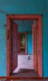 Abandoned doorway. Abandoned double doors open doorway interior in blue-orange colors Royalty Free Stock Image