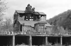 Abandoned double-band Sawmill in Cass, Virginia. Old damaged double-band sawmill in Cass, Viginia Stock Image