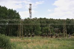 Abandoned electric wires and isolators for transmission of electric energy. Stock Image