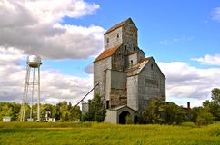 Abandoned elevator and city water tower Stock Images