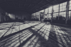 Abandoned empty factory building on sunny summe day.  Royalty Free Stock Photo