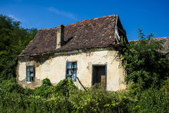 Abandoned empty house which collapsed. Old ruined house in which nobody lives stock photos