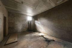 Abandoned empty room with window and rays of light Royalty Free Stock Image