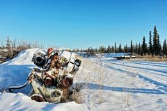 Abandoned engine in the snow stock image