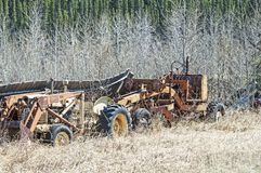 Abandoned Equipment. Sits in Interior Alaska. The days of usefulness have long past. This farm equipment equipment reflects the hard work of days gone by Royalty Free Stock Photography