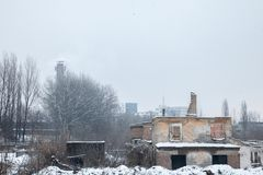 Abandoned factories and warehouses under the snow in Eastern Europe, in Pancevo, Serbia, former Yugoslavia Royalty Free Stock Photos