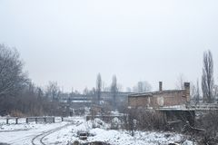 Abandoned factories and warehouses under the snow in Eastern Europe, in Pancevo, Serbia, former Yugoslavia Stock Images
