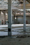 Abandoned factory 15 (focus on the 2 columns). This old building is located in St-Jean sur richelieu, Quebec, Canada royalty free stock photo