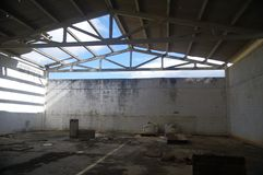 Abandoned factory. Ruins of an ancient factory warehouse royalty free stock photography