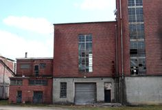 Abandoned factory. An old rundown textile plant stock images