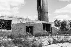 Abandoned Factory with Brick Smokestack and the Remnants of the Power Plant II Stock Photography