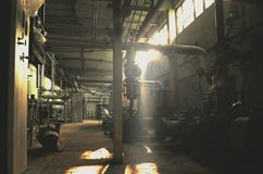 Abandoned, vintage factory building in the morning sunlight Stock Photos