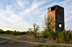 Abandoned factory building, destroyed tower royalty free stock image