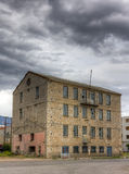 Abandoned factory building under cloudy sky Royalty Free Stock Image