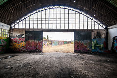 Abandoned factory, destroyed with graffiti on the walls Royalty Free Stock Images