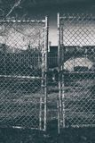 Abandoned Factory Gate with Grunge Effect Stock Image