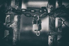 Abandoned Factory Gate Lock with Grunge Effect Royalty Free Stock Image