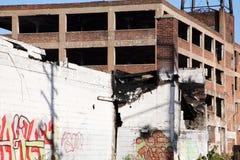 Abandoned factory with graffitti Stock Photo