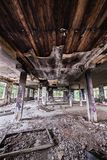 Abandoned factory hall and burnt ceiling stock images
