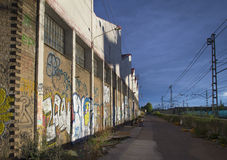 Abandoned factory next to the train Royalty Free Stock Photos