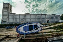 Abandoned Factory outside Cangas in Spain. Old boat and whaling station just outside the small town of Cangas - Galicia, Spain Stock Image