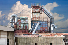 Abandoned factory. An abandoned, rusty and old gas factory Stock Photo