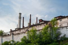 Abandoned factory, save the nature, emissions into the air royalty free stock photo