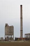 Abandoned factory with smokestack Stock Images