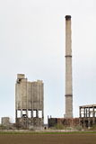 Abandoned factory with smokestack Royalty Free Stock Photo