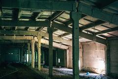 Abandoned factory, warehouse, dark building interior, Apocalypse concept Royalty Free Stock Images