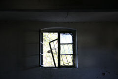 Abandoned factory - window. Abandoned and very devastated factory stock photography