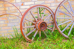 Abandoned faded wooden cart wheels together Royalty Free Stock Images