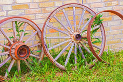 Abandoned faded wooden cart wheels together Stock Photo