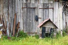 Abandoned farm. Old abandoned barn with old rusty kennel Stock Photos