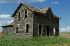 Abandoned Farm Homes that are neglected. Abandoned farm homes sit across the country decaying from mother nature royalty free stock image