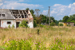 Abandoned farm house in a field Stock Images
