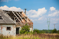 Abandoned farm house in a field Royalty Free Stock Photo