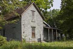 Abandoned Farm House. An abandoned farm house located in Missouri, United States.  Front view of the old house showing the main entrance and porch Stock Photo