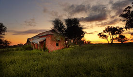 Abandoned farm house at sunset. The abandoned farmhouse where nobody lives.... Once it held laughter Once it held dreams Did they throw it away Did they know royalty free stock photos
