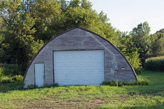 An Abandoned Farm Machine Shed Stock Photography