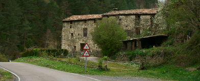 Abandoned farm. Old and abandoned farm aside of a mountain road, in a dark place in Ripolles county, Catalonia (Spain Royalty Free Stock Photography