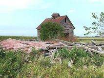 An Abandoned Farm. This is a Summer picture of an abandoned farm along I-55 near Odell, Illinois. This picture features the collapsed farmhouse and the stock photography