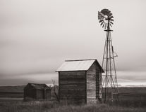 Abandoned farm with windmill Royalty Free Stock Photography