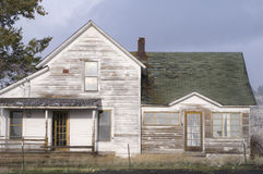 Abandoned Farmhouse. Abandoned derelict farmhouse in eastern Oregon under snowing, cloudy skies Stock Images