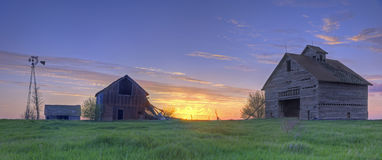 Abandoned Farmhouse and Barn At Sunset Stock Photos