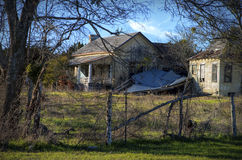 Abandoned farmhouse and cottage in rural Texas. Abandoned, dilapidated farmhouse with cottage and ruins on country road in Texas Royalty Free Stock Photography