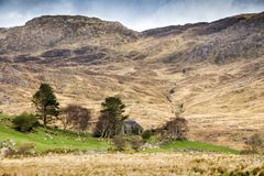 Abandoned Farmhouse in Kerry Highlands. Abandoned Farmhouse in beautiful mountain landscape, Kerry Highlands, south west coast of Ireland Stock Images